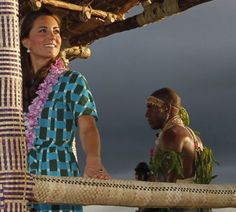 Two's company: Kate and William were joined on the colourful truck by a traditional Solomon Islands warrior