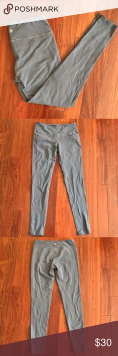 Grey Athleta leggings Really nice condition; no rips, holes, stains or pilling. Worn only a handful of times. Only hang dried after washing! Size large tall Athleta Pants Leggings
