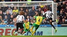 Nov. 23rd. 2013 Newcastle striker Loic Remy (right) heads his side in front against Norwich after only two minutes of play.