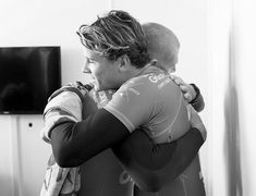 Australian surfer Mick Fanning was comforted by Julian Wilson after Fanning was attacked by a shark at the J-Bay Open in South Africa