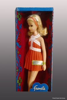 "1971. Twist 'n Turn Francie Doll #1170. Vintage Francie Doll. Barbie Collector. "" 'No bangs' Francie doll, as collectors refer to her, wore an orange pleated swim dress with white vinyl trim and orange panties. She also had white soft buckle shoes."""