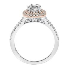 Beautiful two tone engagement ring with rose gold halo and cushion cut diamond