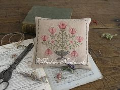 Martha Tizwell's Tulips in Pinkeeps, Pin Pillows & Pincushions pattern $11.00 on Worked of Thread and Linen at http://workedofthreadandlinen.blogspot.com/p/pinkeeps-pin-pillows-pincushions_13.html