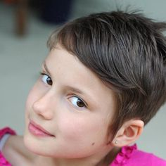 Little girl with a short, pixie cut