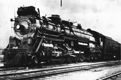 """This black and white photograph shows a view of the Atchison, Topeka & Santa Fe Railway Company's steam-powered """"Madam Queen"""" F #5000. The locomotive was a 2-10-4, Texas type, purchased from Baldwin Locomotive Works in 1930.  Creator: Atchison, Topeka, and Santa Fe Railway Company Date: Between 1930 and 1945"""