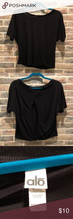 ALO yoga black top with keyhole back Black alo shirt with keyhole back. Size large but runs small. Great for working out or running errands. Comfortable and cute! ALO Yoga Tops Tees - Short Sleeve