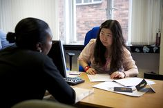 An adviser supporting a client at the Refugee and Migrant Centre in Wolverhampton.