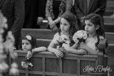 Flowergirls during wedding ceremony. Greek Orthodox Wedding, Greek Orthodox Cathedral Annunciation Of The Virgin Mary Church, Toronto.