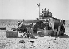 A crew of No. 2 Armoured Car Company RAF bivouacked with their Fordson Armoured Car, during a halt while on patrol in the Western Desert. Pin by Paolo Marzioli American Ambulance, Afrika Corps, North African Campaign, German Submarines, Armored Fighting Vehicle, Ww2 Tanks, Armored Vehicles, Armored Car, Royal Air Force