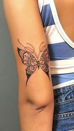 4c7bf1bc6c66b Small Black Butterfly Arm Tattoo Ideas for Women - www.MyBodiArt.com Butterfly  Mandala