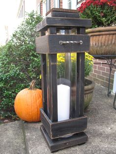 Lighting is something a little more challenging to DIY. Solar patio lights can be created from any of the above mentioned lighting choices. A lot of people feel that solar outdoor lights aren't as bright at electrical ones and for… Continue Reading → Porch Lanterns, Floor Lanterns, Tall Lanterns, Wooden Lanterns, Porch Lighting, Exterior Lighting, Lantern Craft, Diy Exterior, Porch Flooring