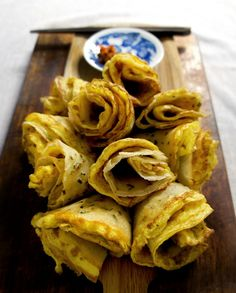 chinese breakfast egg crepes //      1 1/2 cup of all purpose flour     1/2 cup of tapioca starch/flour     5 tbsp of finely diced chives or scallions     1 tsp of sugar     1/4 tsp of salt     1/8 tsp of black pepper and white pepper each     1 4/5  cups of water     1/4 cup of vegetable oil     8 large eggs     3 tbsp of milk     1/2 tsp of salt     White pepper for dusting