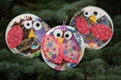 paper plate owls. Paper plates, paint (can use brush, sponge or dabber dots).  2 sizes of colorful fabric cut in shape of wings, Foam circle and black buttons for eyes. Foam beak. Flower shape adhesive foam pieces cut in half for feet.  Can apply wings by dipping paint brush in glue and brush on owl body.