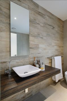 SOUTH COOGEE - House This bathroom combines a neutral palette with earthy textures. A recycled timber vanity and timber look tiles feels like you have brought the mountains to the Eastern Suburbs of Sydney.  http://www.houzz.com/photos/2910564/SOUTH-COOGEE---House-contemporary-bathroom-sydney