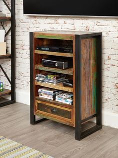 Urban Chic Entertainment Cabinet - This impressive entertainment unit will stand out in any room. The steel frame sets of the colourful wood to create a stunning piece of furniture. It features a number of shelves and drawers for handy storage.