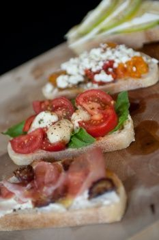 Try basil and tomato with fresh mozzarella drizzled with olive oil and dotted with black pepper. Layer prosciutto and figs over mascarpone, diced roasted peppers over goat cheese, or apples and Brie.  Allow 6 slices per person.