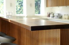 We specialise in manufacturing bespoke solid hardwood worktops. Made from wide planks or single staves of Iroko, Maple, Oak, Walnut, Ash & Cherry. Richmond London, Wide Plank, Work Surface, Work Tops, Walnut Worktops, Hardwood, Kitchen, Bar, Breakfast