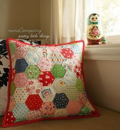 well, yes, i did drop everything to make this pillow once i felt that i simply couldn't stop the process~ and i wasn't even sure what i wanted to do with the hexagons (mini quilt, seat cushion, tote bag?) but now that i'm done i want to make more... which is horrible, because i have customers and customers waiting!