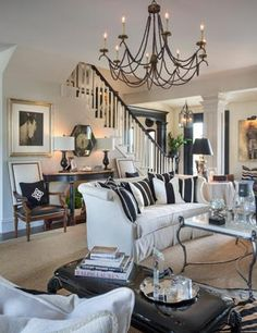 Room Joy Tribout. Love the patent leather bench/coffee table!