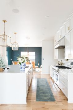 * white walls in kitchen, blue walls in dining area