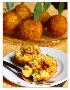 Sicilian Arancine   These fried rice balls resemble oranges - the Italian word for orange is arancia.  They can be stuffed with a variety of mixtures, but a meat sauce, or ragu, is the most traditional.