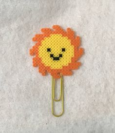 This Sunshine Planner clip or magnet is a fun and happy way to celebrate the summer season! Check out Happy Hearts Paper Co. on Etsy and Instagram for fun planner ideas, planner accessories, magnets, and more! Also tons of handmade perler bead creations. #plannerideas #planners #perlerbeads #happyplanner #giftideas #bookmarks #officedecor #deskdecor
