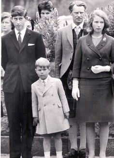 1965 Charles, with Andrew and Anne, casts a close eye over a guard of honour
