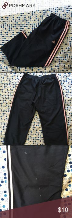 Final reduction Adidas Track Pants These adidas track pants are navy blue and light pink. They are 100% polyester. They have a couple of white stains on the front of the leg and one very small hole on the same leg. All is pictured above. They also have one small pocket. Feel free to ask any questions. adidas Pants Track Pants & Joggers