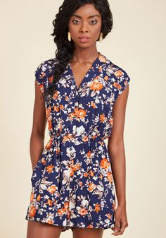 <p>Spend a winning afternoon with a bittersweet love story, hot tea, and the cool comfort of this collared romper. Sporting its vintage-inspired design, sepia-toned florals with a pop of orange, smocked waistline, and slit pockets, you know you'll look back fondly on this utterly perfect day.</p>