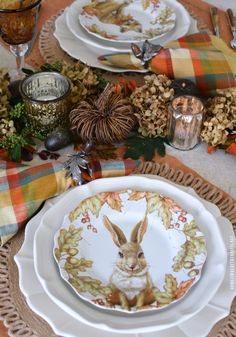 Fall table with woodland friends salad plates and natural DIY table runner with leaves, acorns, dried hydrangeas and votives | homeiswheretheboatis.net