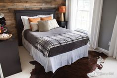 Add some fall elements to a bedroom with a flannel blanket, touches of orange and a reclaimed wood headboard. Bedroom Murals, Home Bedroom, Bedroom Decor, Bedroom Ideas, Bedroom Rustic, Gray Bedroom, Bed Ideas, Bedroom Inspiration, Bedroom Furniture