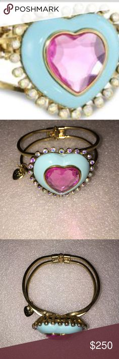 Betsey Johnson bangle Selling to buy Betsey pieces I need. This is from the candyland collection. The gorgeous bracelet is a bangle . The bangle had a large baby blue heart with rhinestones and a pink heart stone. Nwot. Betsey Johnson Jewelry Bracelets