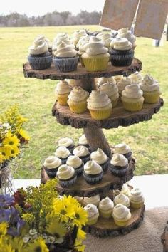 Do-it-yourself Wedding Ideas For 2013, Rustic And Country: The groom used a chain saw to cut the log rounds for this cupcake tower, seen on Etsy and Pinterest.  - Photo by @WireImgId=2621707
