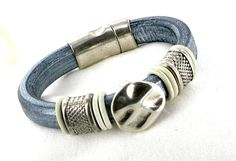 Hey, I found this really awesome Etsy listing at https://www.etsy.com/listing/169140072/regaliz-leather-bracelet-pearlized-gray