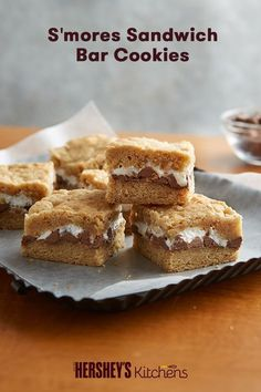 S'mores Sandwich Bar Cookies are fun for the kids and easy to make. Made with HERSHEY'S Milk Chocolate Bars, graham cracker crumbs, and miniature marshmallows, these cookies will soon be a classic. Nothing like S'more Fun even in the fall and winter. Cookie Desserts, Cookie Bars, Bar Cookies, Cookie Recipes, Dessert Recipes, Yummy Recipes, Sandwich Bar, Sandwiches, Sandwich Ideas