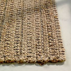 braided stripe jute rug to add subtle pattern and rich texture