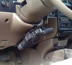 Steering Wheel Column Holster Mount - I've always liked the idea in this pic. Needs to be changed to a solid kydex holster though. Tactical Life, Tactical Gear, Tactical Truck, Tactical Equipment, Jeep Jk, Wrangler Jeep, Jeep Rubicon, Guns And Ammo, Zombie Apocalypse