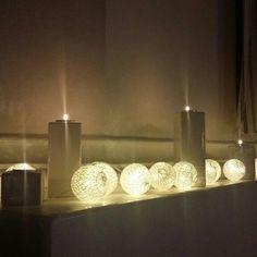 Light balls and tea lights on the fireplace.