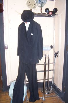 Men's suit and accessories from The Costume Shop