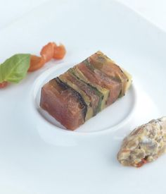 This vibrant tomato and basil terrine recipe includes a spicy aubergine, pepper and banana shallot relish cut with creamy mascarpone. - Frances Atkins