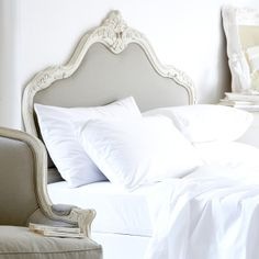 Love the headboard... with white fluffy sheets and a down comforter.