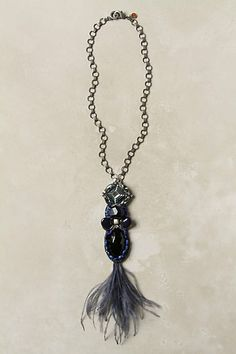 "Azure Crest Necklace  Lobster clasp  Glass, onyx,lapis, crystal, brass, ostrich feather  18""L  9"" pendant  $278"