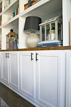 Kitchen cabinets as base to bookcases More