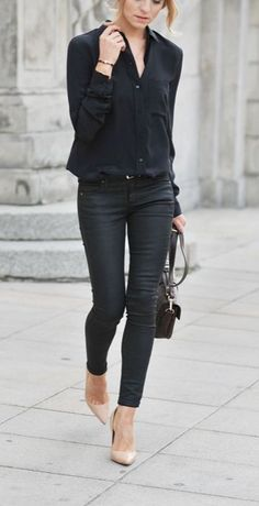 Rock a black button front blouse with black slim jeans and you'll look like a total babe. Elevate this ensemble with nude leather pumps.