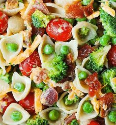 2 c broccoli florets blanched & chopped 10 slices bacon cooked crumbled 1 c cherry tomatoes halved 1 c shredded sharp cheddar 1 c sweet peas thawed 8 oz pasta shells cooked 2/3 c mayo 1/2 c buttermilk 1 or 2 tablespoons dry Ranch mix