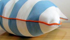 Turquoise and white striped scatter cushion cover with orange piping