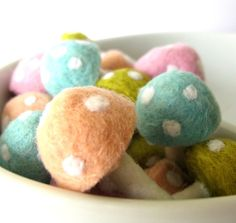 wool felted mushrooms. Would make a great easter display