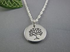 Family Tree Necklace, Sterling Silver Tree,Tree of Life Necklace, Sterling Silver Tree of LIfe Small Etched Charm. $28.80, via Etsy.