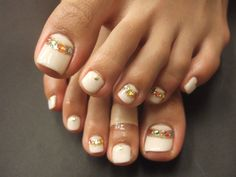 White toes with gold band and rhinestones