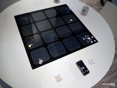 Panasonic shows off solar-powered wireless charging table